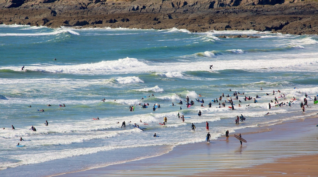 Croyde featuring swimming and a sandy beach as well as a large group of people