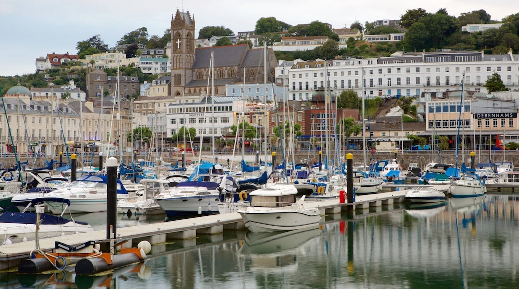Torquay showing a bay or harbour, general coastal views and a coastal town