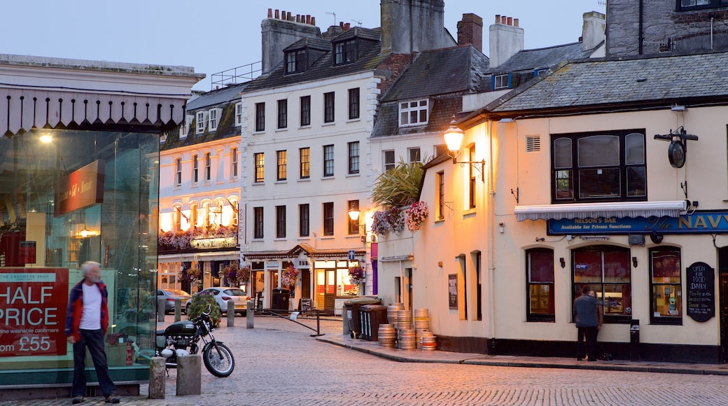 Plymouth which includes night scenes, a coastal town and street scenes