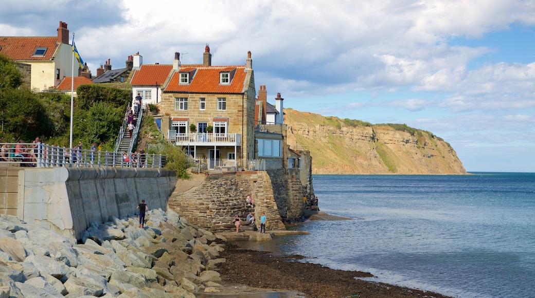 Robin Hood\'s Bay Beach showing a coastal town, rugged coastline and general coastal views