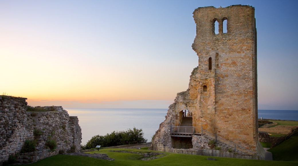 Scarborough Castle showing a sunset, a ruin and general coastal views