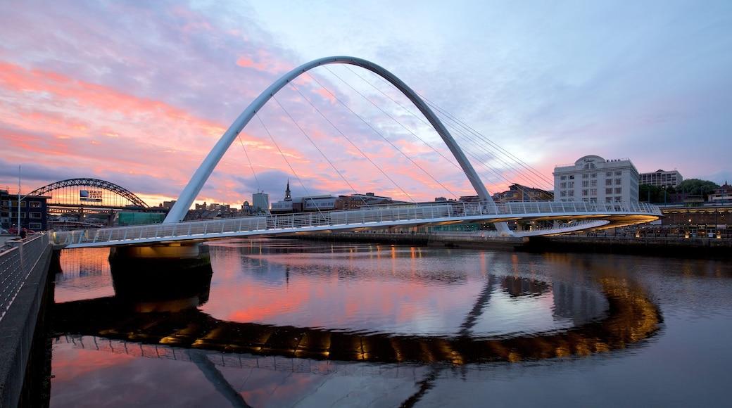 Gateshead Millennium Bridge featuring a city, a river or creek and modern architecture