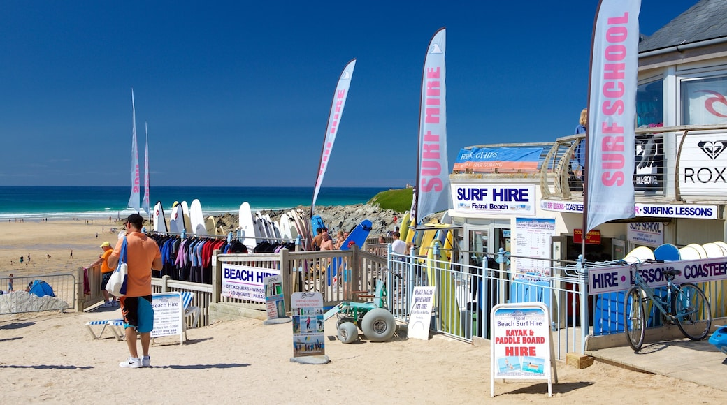 Fistral Beach which includes signage and a sandy beach as well as an individual male