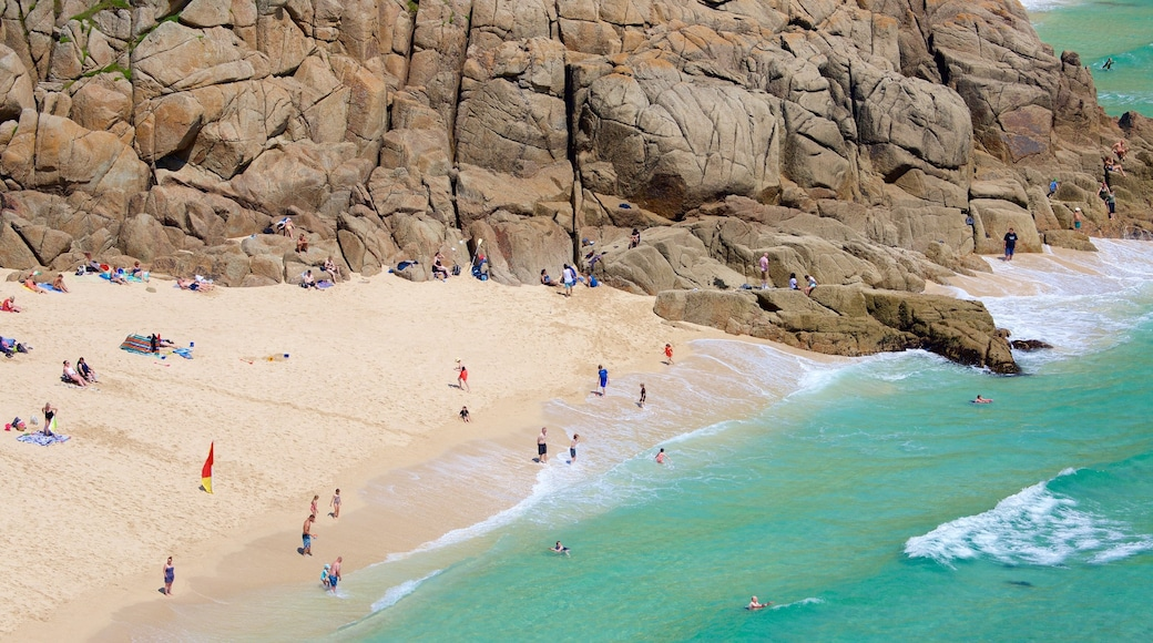 Porthcurno Beach which includes general coastal views, a beach and swimming