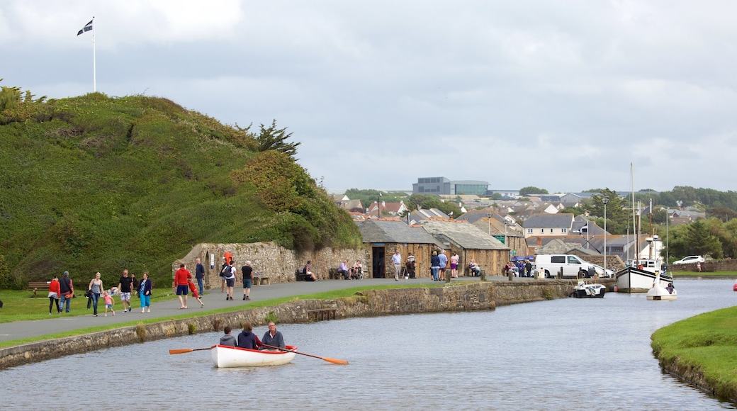 Bude which includes boating and a coastal town as well as a large group of people