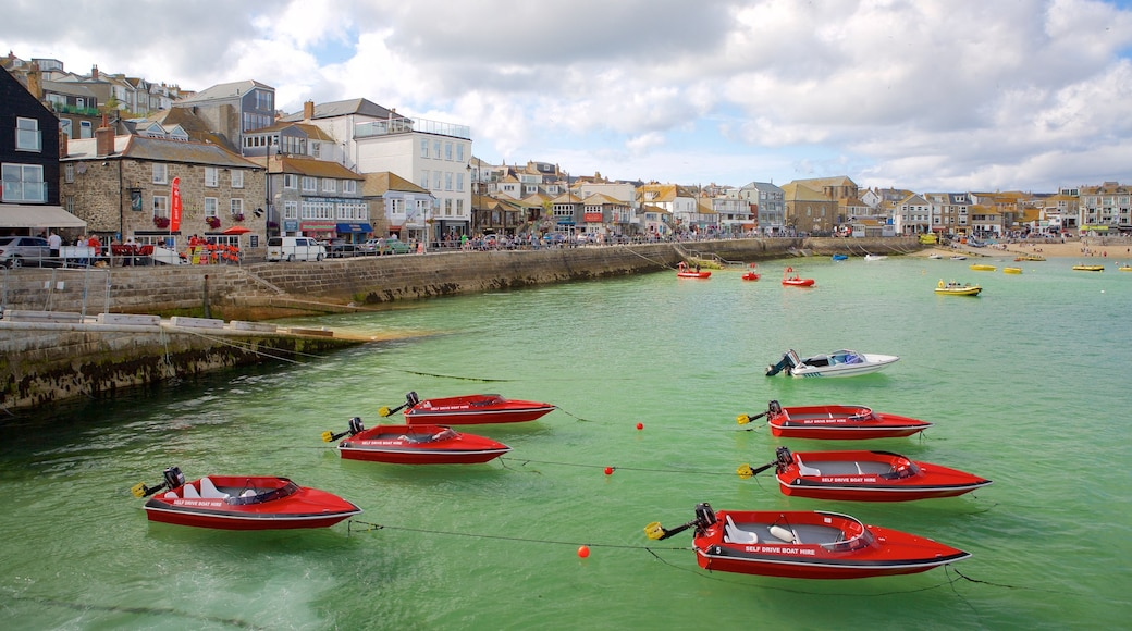 St Ives showing rugged coastline, boating and a coastal town
