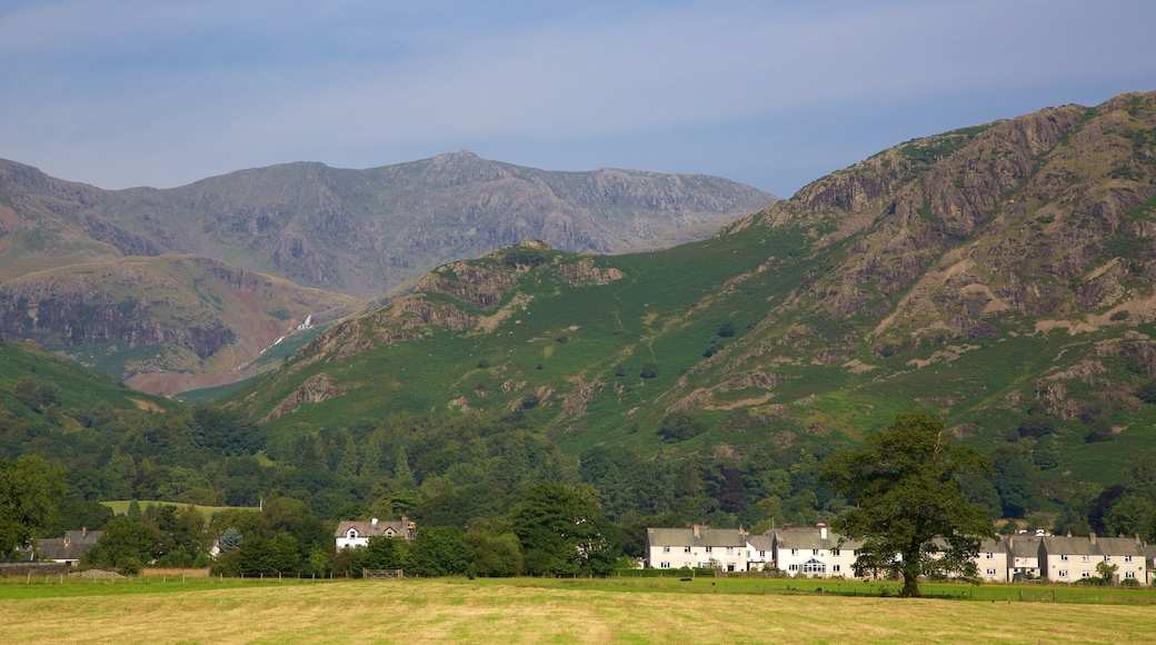 Coniston Water which includes mountains and a small town or village