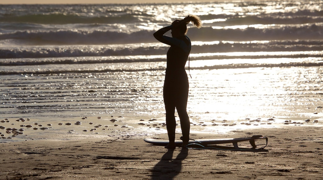 Woolacombe showing a beach and surfing as well as an individual femail