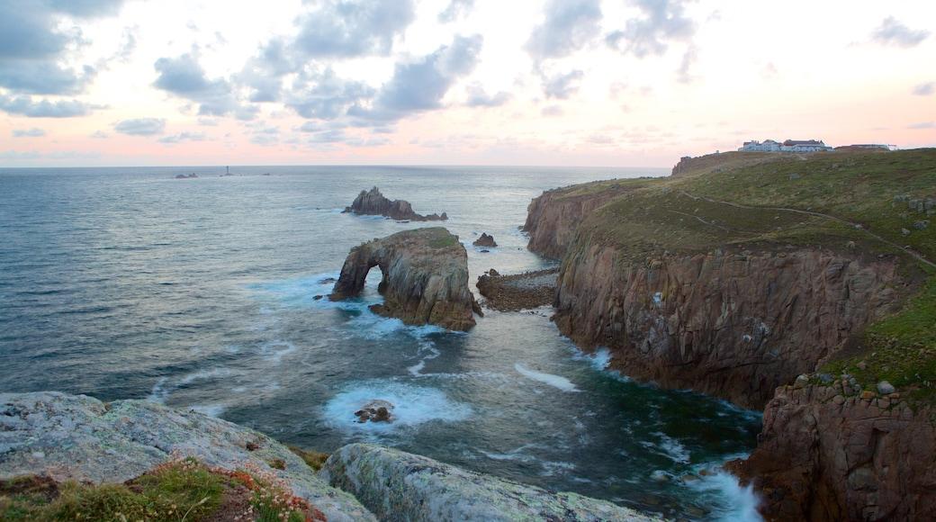 Land\'s End showing a sunset, landscape views and rocky coastline