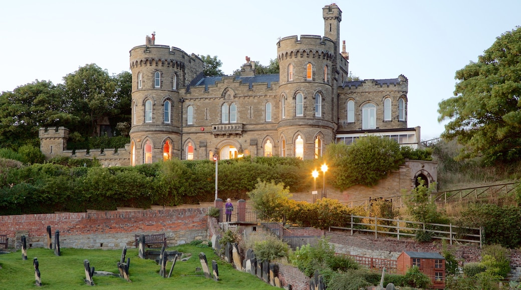 Scarborough Castle featuring a garden, chateau or palace and heritage architecture