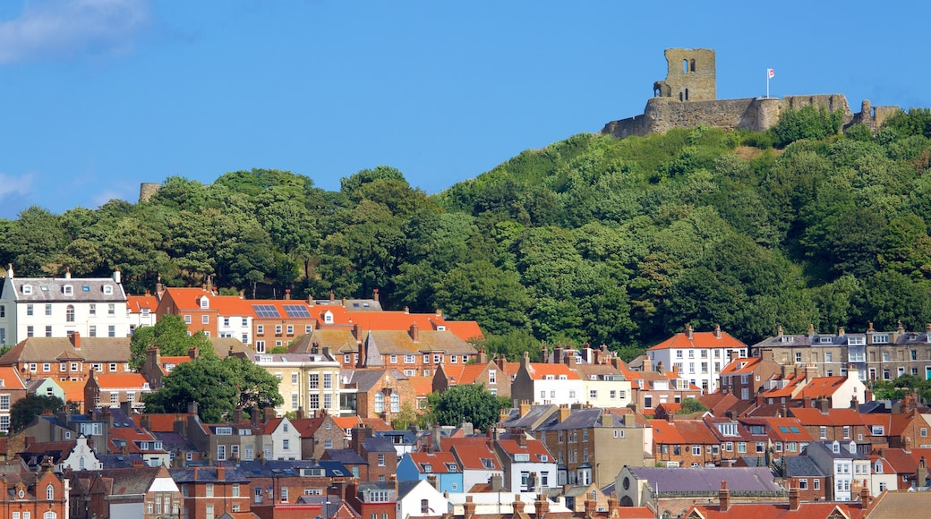 Scarborough Castle featuring a ruin, a castle and a small town or village