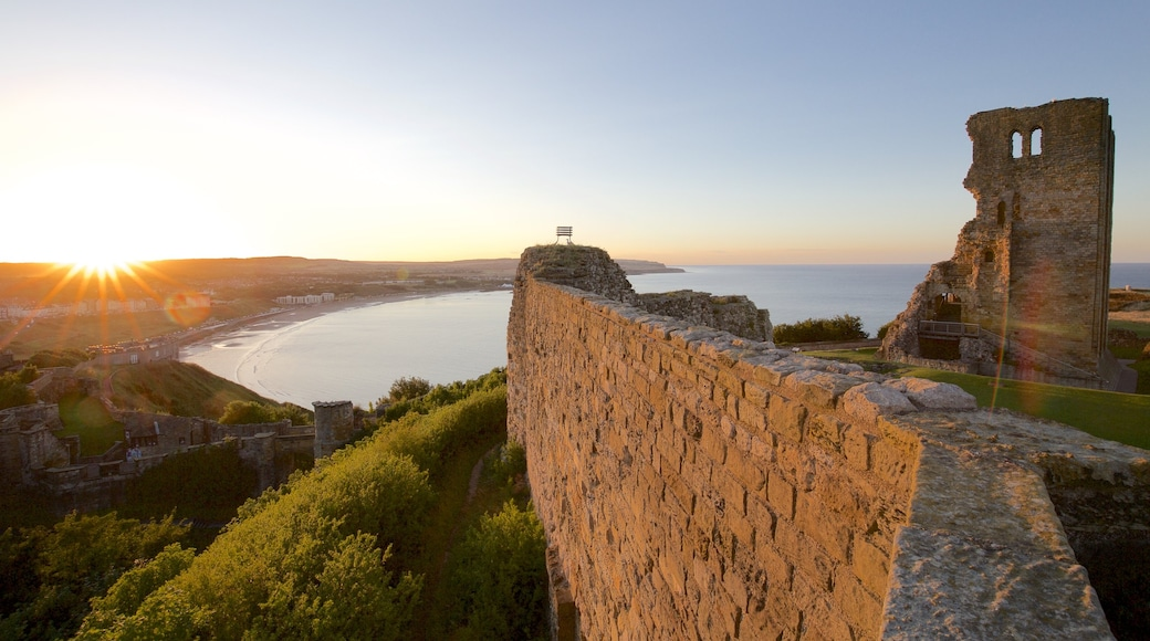 Scarborough Castle featuring a sunset, building ruins and a castle