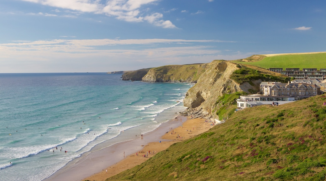 Watergate Bay featuring rugged coastline, a house and a sandy beach