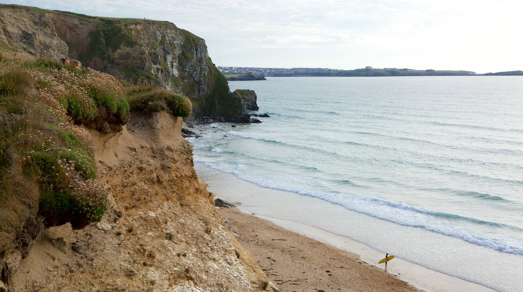 Watergate Bay showing a sandy beach and rocky coastline