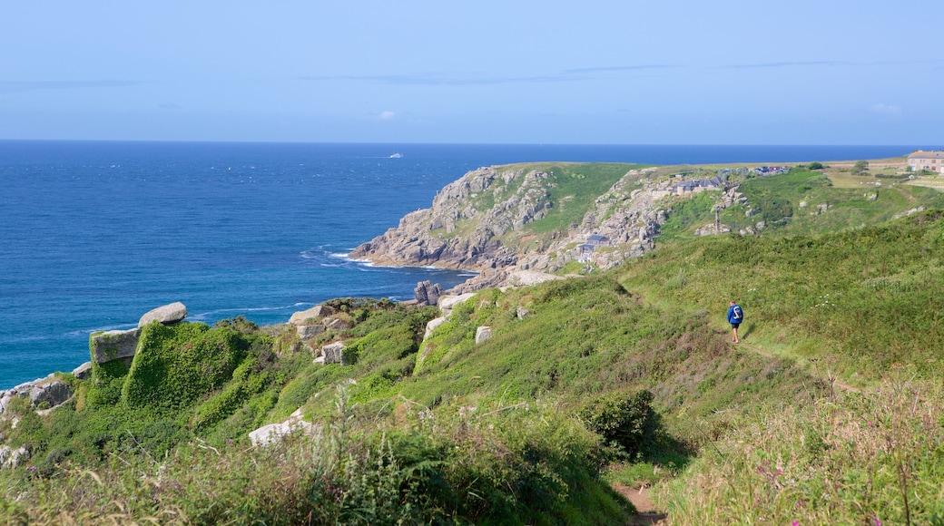 Porthcurno Beach featuring tranquil scenes, rocky coastline and landscape views