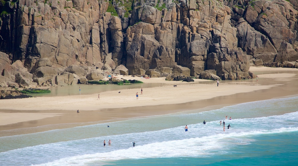 Porthcurno Beach showing rocky coastline and a sandy beach