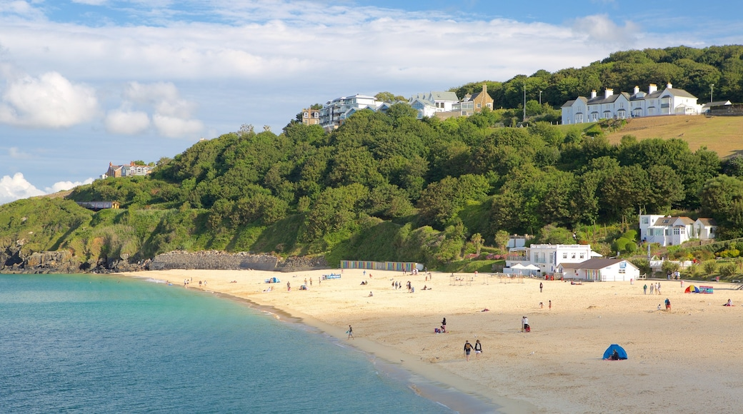 Porthminster Beach which includes a sandy beach and a coastal town