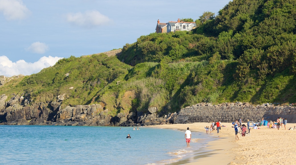 Porthminster Beach showing a coastal town, a beach and swimming