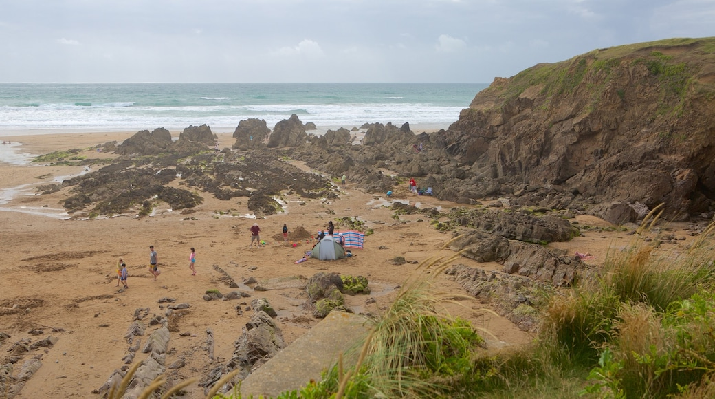 Crooklets Beach which includes a coastal town and general coastal views
