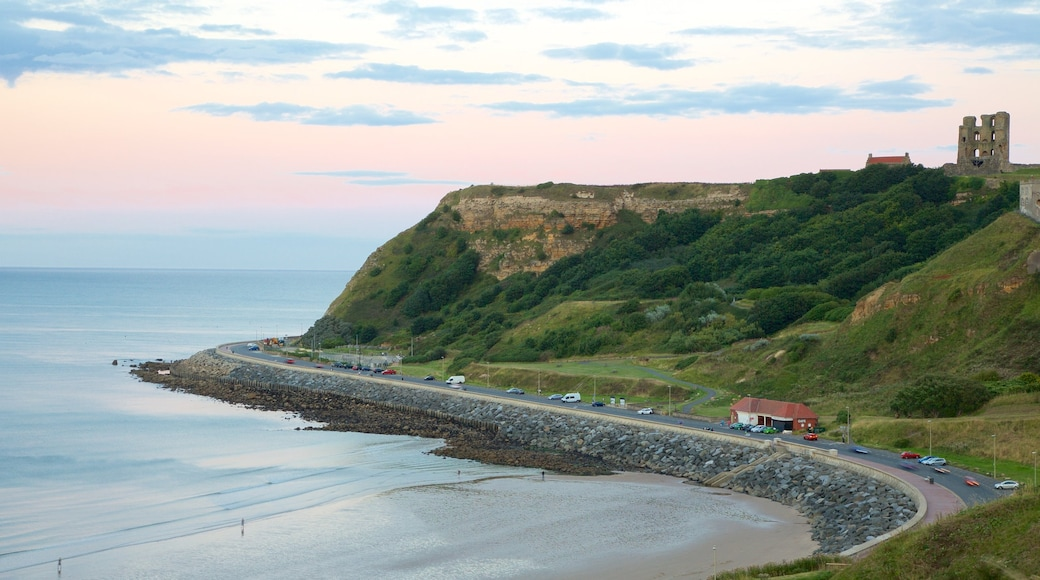 North Bay Beach showing a sunset, landscape views and a coastal town
