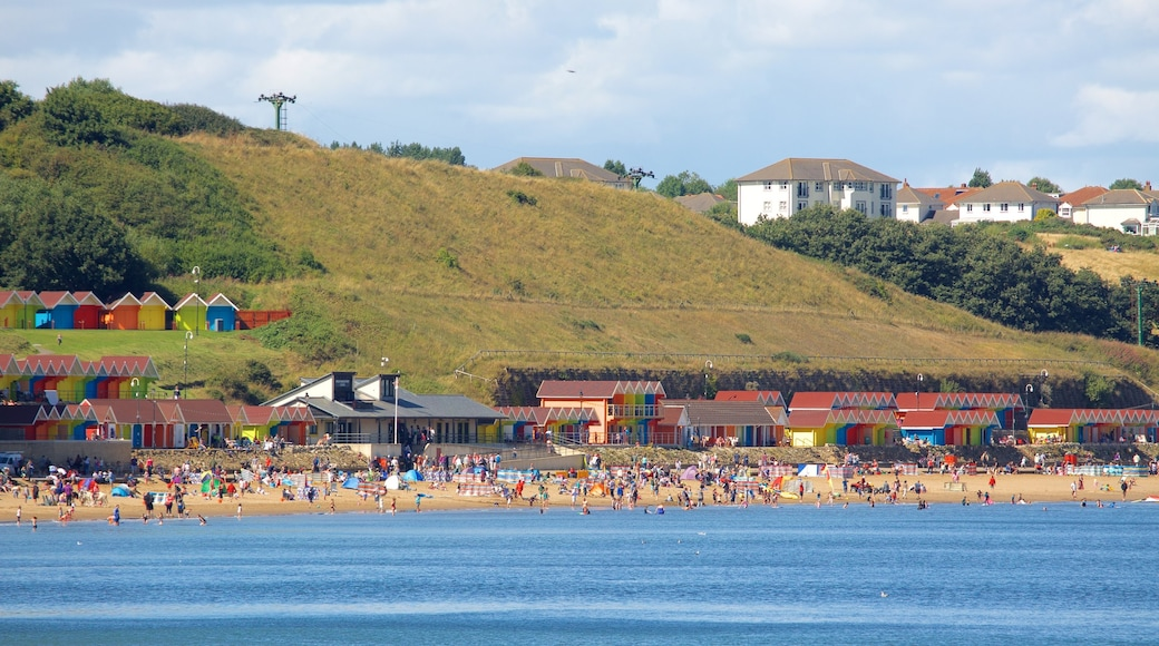 North Bay Beach featuring a beach and a coastal town as well as a large group of people