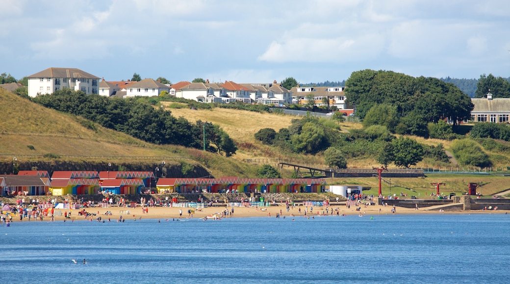 North Bay Beach featuring a coastal town and a beach as well as a large group of people