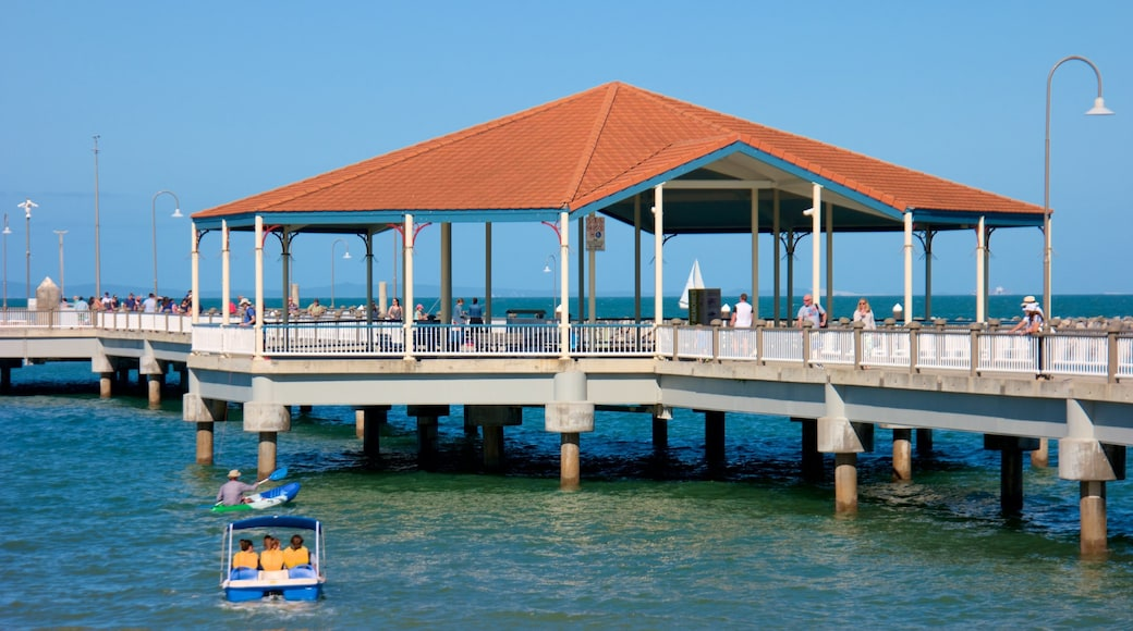 Redcliffe showing general coastal views as well as a small group of people