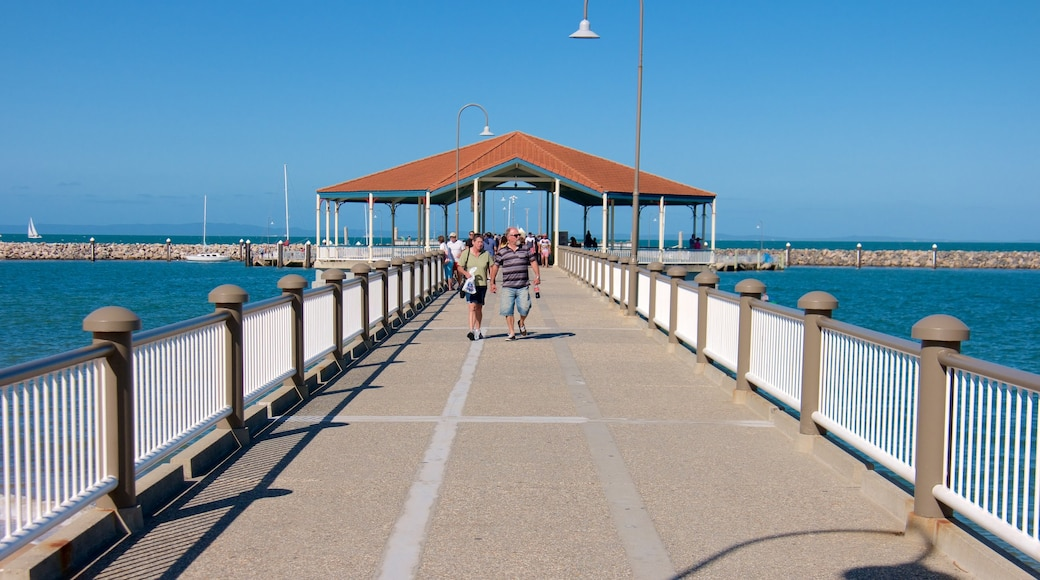 Redcliffe featuring general coastal views as well as a small group of people