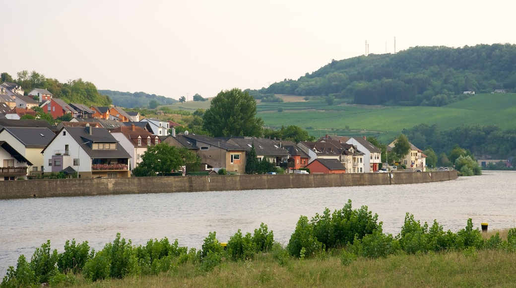 Luxembourg which includes a lake or waterhole and a small town or village