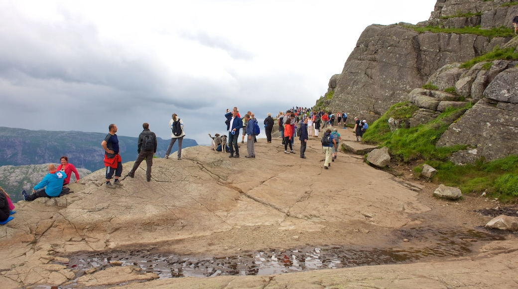 Preikestolen showing hiking or walking as well as a large group of people