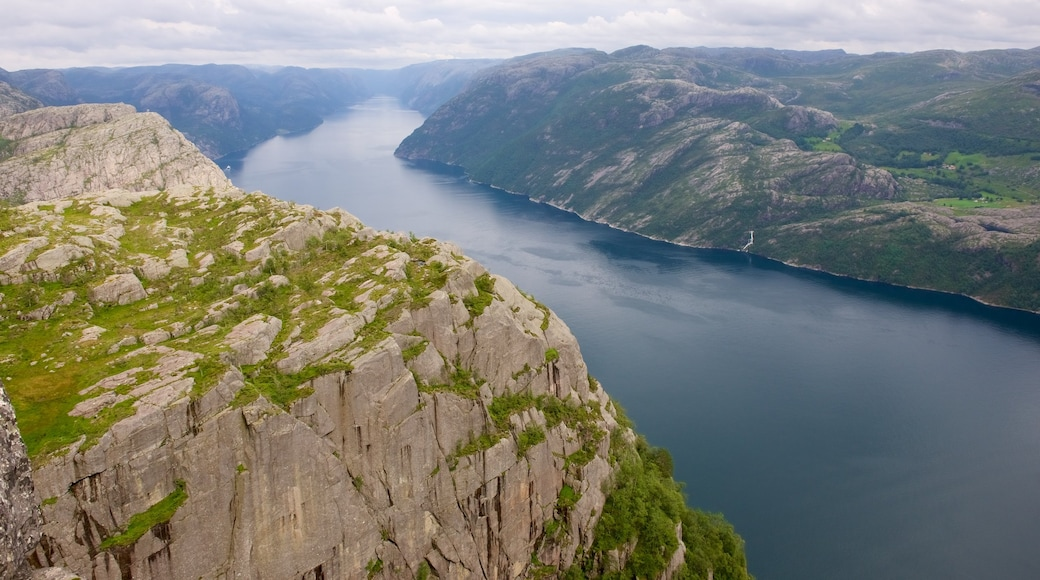 Preikestolen which includes a lake or waterhole, mountains and landscape views