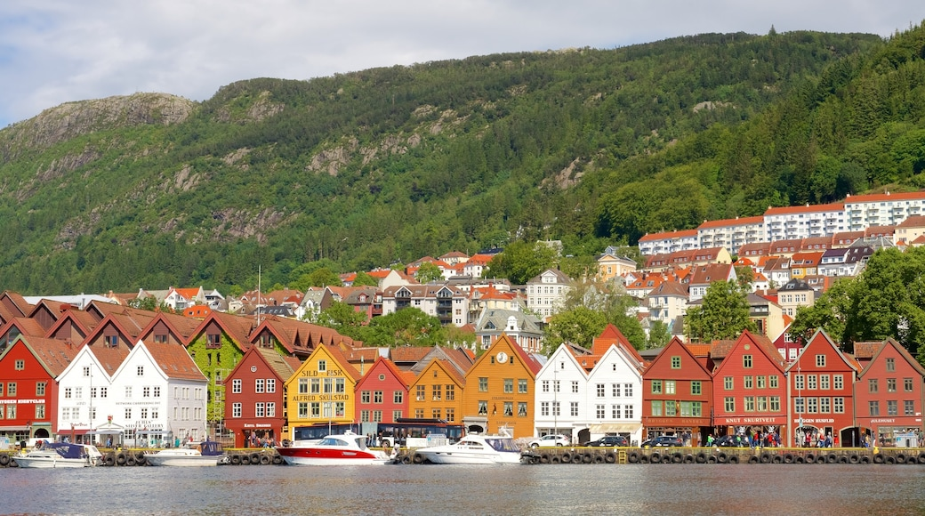 Bryggen featuring rugged coastline, a small town or village and boating