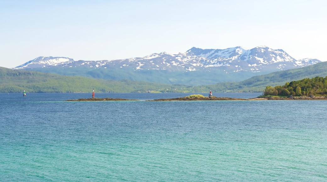 Finnsnes which includes general coastal views and mountains