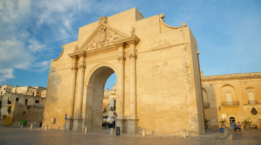 Arco di Trionfo which includes a sunset, heritage architecture and a square or plaza