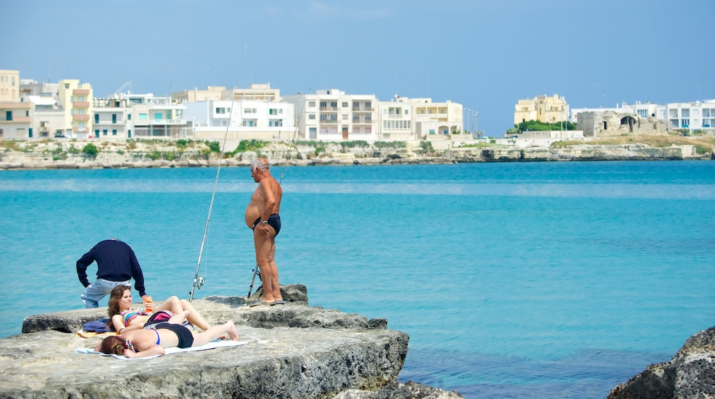 Otranto Waterfront which includes general coastal views and a city as well as a small group of people