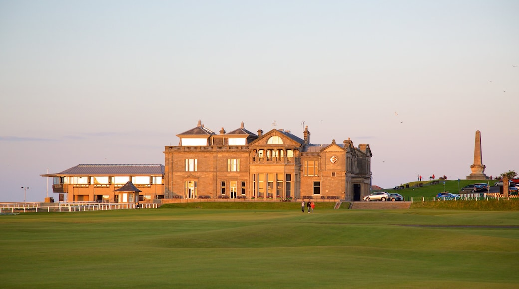 St. Andrew Links showing golf, a sunset and heritage architecture