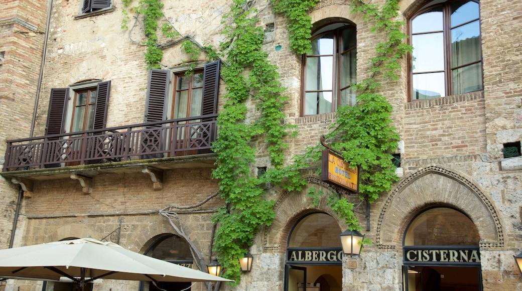 Piazza della Cisterna featuring signage