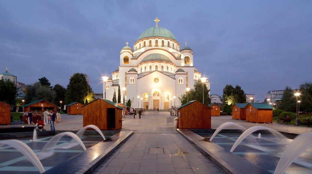 Cathedral of Saint Sava showing a city, a fountain and a church or cathedral