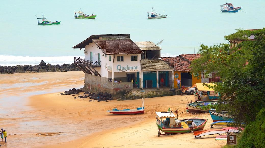 Baia Formosa showing a coastal town, a sandy beach and boating