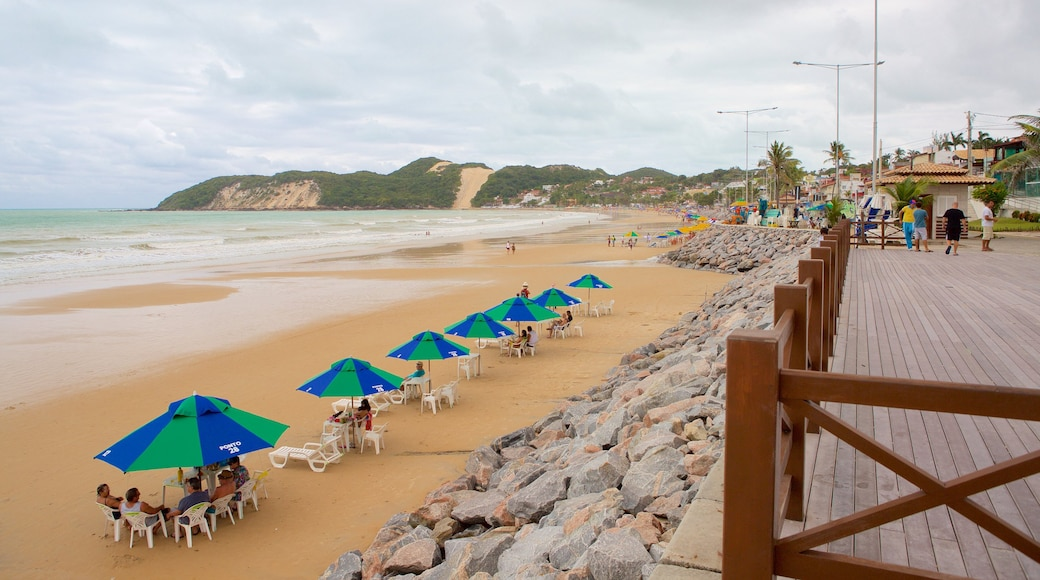 Ponta Negra Beach featuring a beach and general coastal views as well as a small group of people