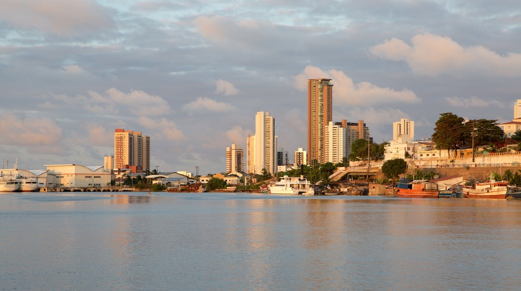 Natal which includes a bay or harbour, skyline and boating
