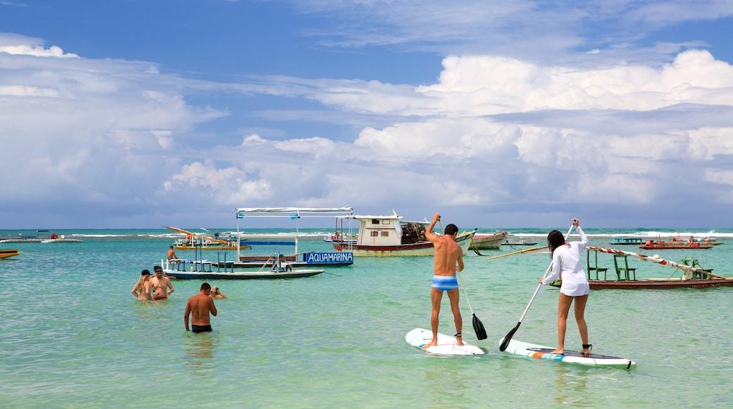 Porto de Galinhas mostrando natação, paisagens litorâneas e esportes aquáticos