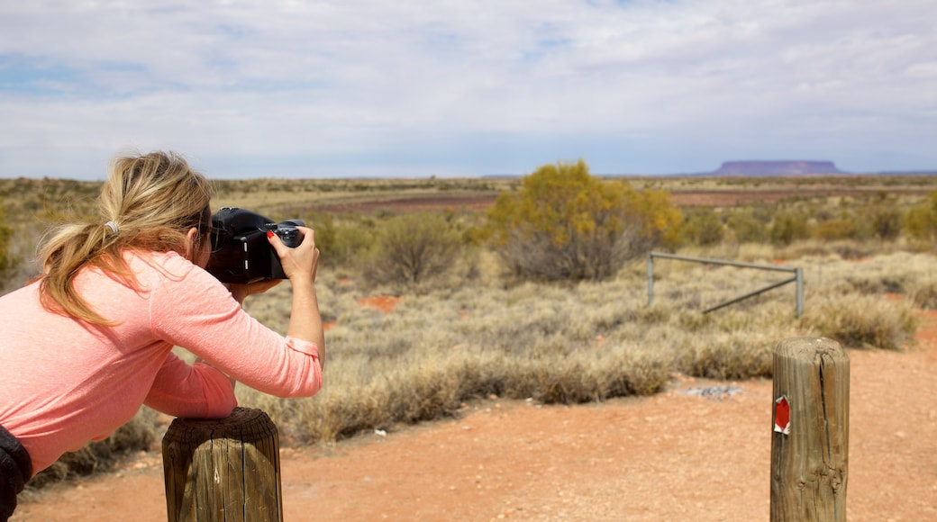Alice Springs which includes desert views as well as an individual female