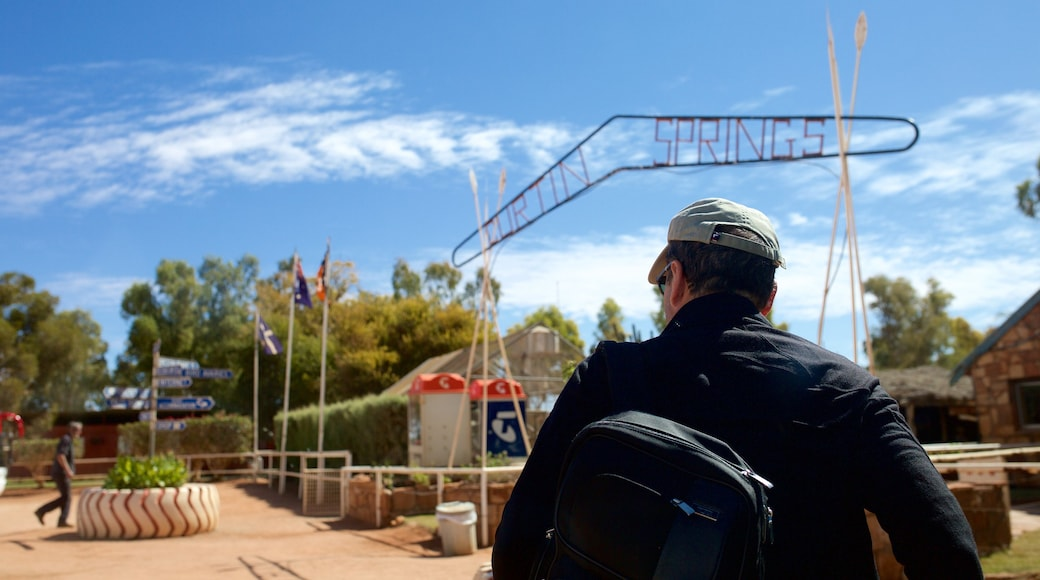 Red Centre featuring signage and tranquil scenes as well as an individual male