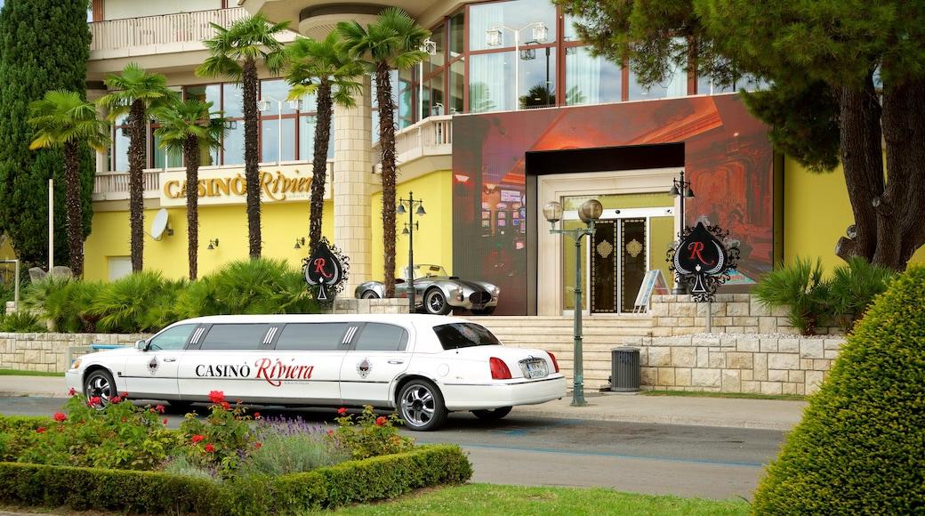 Portoroz Beach featuring a coastal town and a luxury hotel or resort