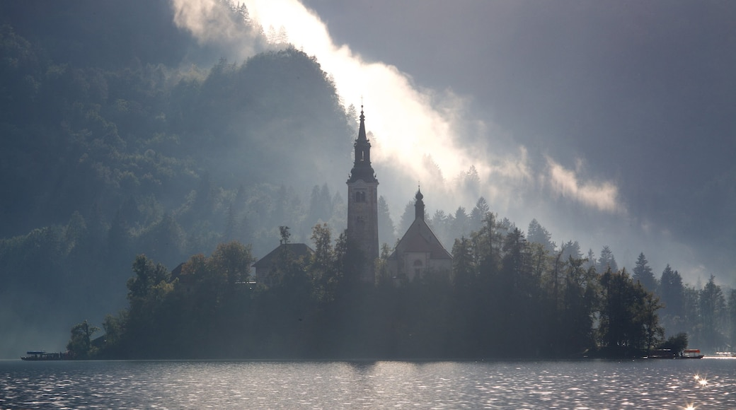 Church of Sv Marika Bozja featuring a lake or waterhole, a castle and mist or fog