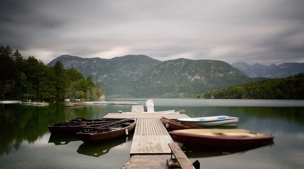 Lake Bohinj which includes mountains, boating and a lake or waterhole