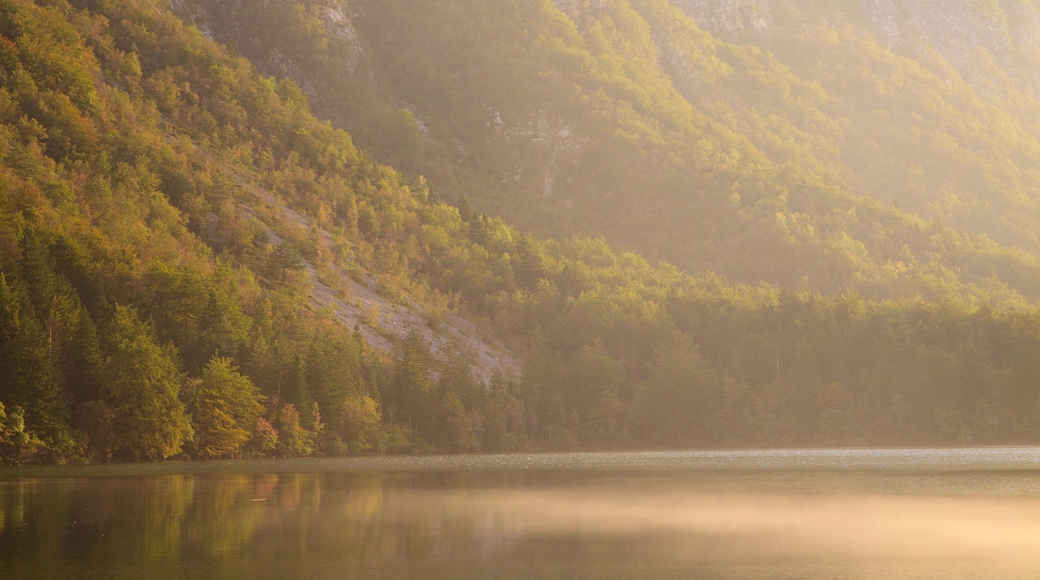 Lake Bohinj which includes a sunset, a lake or waterhole and mountains