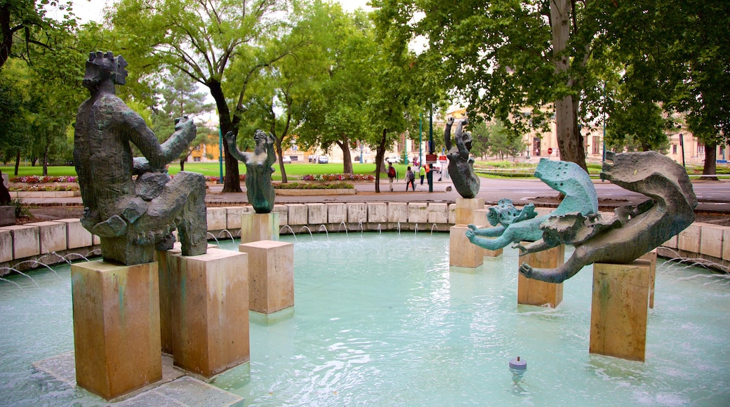 City Park featuring a statue or sculpture, a fountain and a garden