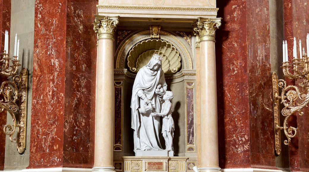 St. Stephen\'s Basilica showing a statue or sculpture, a church or cathedral and religious aspects